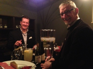 Board chair Jon Dewey tends bar for K.E.E.P. Yalecrest member Dave Mash